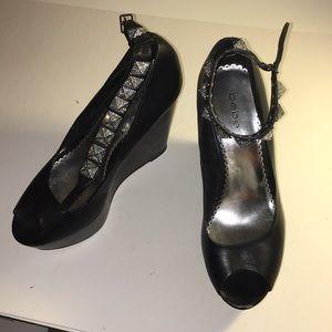Bebe open toe studded wedge heels.